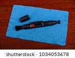 black cleaning tool on blue... | Shutterstock . vector #1034053678