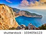 navagio beach with shipwreck... | Shutterstock . vector #1034056123