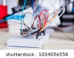 breadboard connected to arduino.... | Shutterstock . vector #1034056558