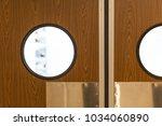 restaurant kitchen entrance.... | Shutterstock . vector #1034060890