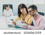 colleagues working at office in ...   Shutterstock . vector #1034061559