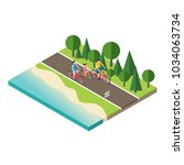 family cycling on countryside... | Shutterstock .eps vector #1034063734