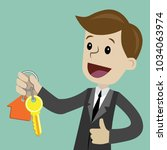 businessman hand buying a house.... | Shutterstock .eps vector #1034063974