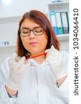 girl teen in the laboratory of... | Shutterstock . vector #1034066410