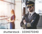 handsome male pilot and... | Shutterstock . vector #1034070340
