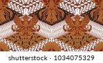batik motif repeated pattern of ... | Shutterstock .eps vector #1034075329