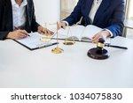 teamwork of business lawyer... | Shutterstock . vector #1034075830