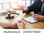 male lawyer or judge consult... | Shutterstock . vector #1034075860