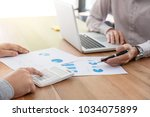 business team two colleagues... | Shutterstock . vector #1034075899