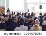 speaker giving a talk in... | Shutterstock . vector #1034078050
