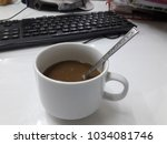 one morning coffee in front of... | Shutterstock . vector #1034081746