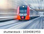 modern high speed train moves... | Shutterstock . vector #1034081953