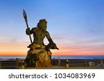 Small photo of Virginia Beach, Virginia - April, 2016: The King Neptune Statue at Virginia Beach Before Sunrise. King Neptune is a large bronze statue sculpted by Paul DiPasquale located in Virginia Beach.