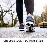 people legs sport shoe walk in...   Shutterstock . vector #1034086426