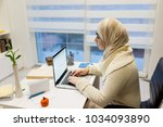 young muslim girl wotking on... | Shutterstock . vector #1034093890