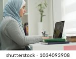 young muslim girl wotking on... | Shutterstock . vector #1034093908