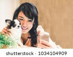 beautiful asian woman taking... | Shutterstock . vector #1034104909