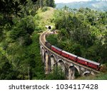 Train On Large Bridge.nine Arc...