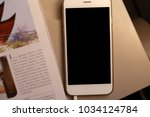 mockup smartphone and book on... | Shutterstock . vector #1034124784