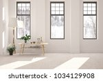 white empty room with table and ... | Shutterstock . vector #1034129908