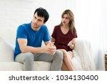 couple having argument conflict ... | Shutterstock . vector #1034130400