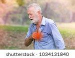 man experiencing discomfort in... | Shutterstock . vector #1034131840