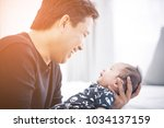 proud father holding his... | Shutterstock . vector #1034137159