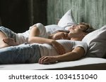 young couple having nap concept ... | Shutterstock . vector #1034151040