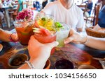 friends toasting  saying cheers ... | Shutterstock . vector #1034156650