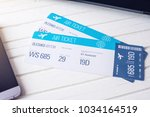 two tickets are on the table... | Shutterstock . vector #1034164519