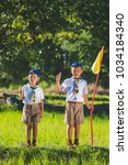Small photo of Boy scout making an oath at the forest.