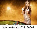 gorgeous young woman in evening ...   Shutterstock . vector #1034184544