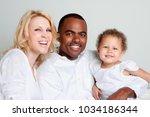 happy mixed race family... | Shutterstock . vector #1034186344