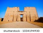 the main entrance of edfu... | Shutterstock . vector #1034194930