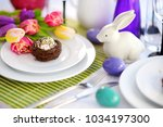 beautiful table setting with... | Shutterstock . vector #1034197300