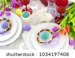 beautiful table setting with... | Shutterstock . vector #1034197408
