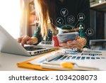 businesswoman hand working... | Shutterstock . vector #1034208073