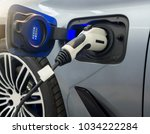 close up of electric car socket ... | Shutterstock . vector #1034222284