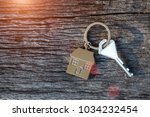keychain with house symbol  key ... | Shutterstock . vector #1034232454