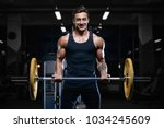 handsome young fit muscular... | Shutterstock . vector #1034245609