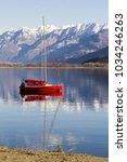 red boat in como lake in gera...   Shutterstock . vector #1034246263
