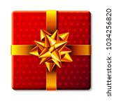 wrapped gift box icon with... | Shutterstock . vector #1034256820