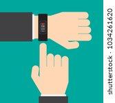 smart watch on the hand of...   Shutterstock .eps vector #1034261620