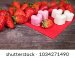 Small photo of Frozen yogurt in a heart shape, Strawberries and froyo bites on wooden table