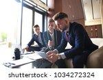 startup business team on... | Shutterstock . vector #1034272324