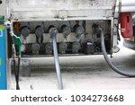 big truck hoses for fuel... | Shutterstock . vector #1034273668