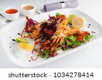lobster on a white plate with... | Shutterstock . vector #1034278414