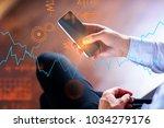 close up of businessman hands... | Shutterstock . vector #1034279176