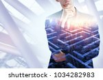 thoughtful businessman on... | Shutterstock . vector #1034282983