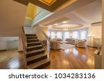 interior of a luxury living... | Shutterstock . vector #1034283136